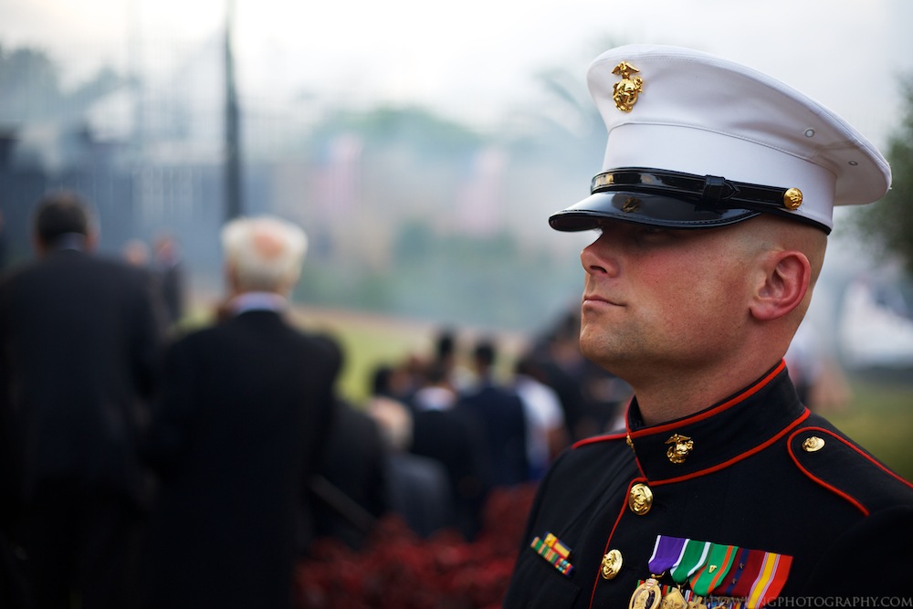 Gunnery Sergeant J. Taylor watches over the USMC Rabat detachment prior to color guard and the singing of the National Anthem. Rabat, Morocco.
